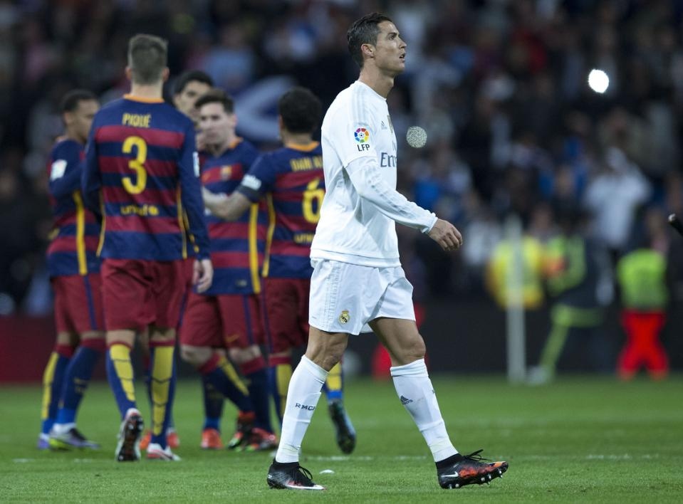 MADRID, SPAIN - NOVEMBER 21:  Cristiano Ronaldo of Real Madrid CF leaves the pithc as FC Barcelona players celebrate their victory after the La Liga match between Real Madrid CF and FC Barcelona at Estadio Santiago Bernabeu on November 21, 2015 in Madrid, Spain.  (Photo by Gonzalo Arroyo Moreno/Getty Images)